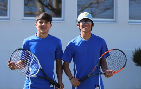 Teammates German Mejia and Marvin Gama smiling before their games. Tennis has made them become very close friends.