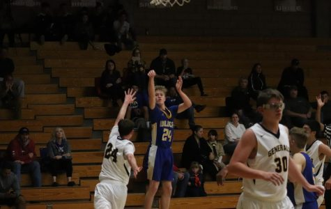 Sophomore Connor McAfee pulls up a three pointer in their away loss to Shafter.