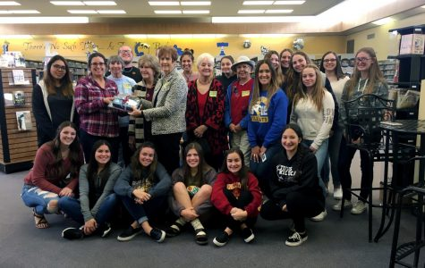 S-Club poses with members of the Soroptimist International of Taft Club while donating books about women empowerment.