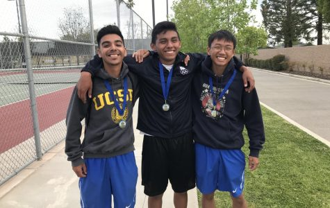 All smiles for seniors Brian Rivera, Rudolpho Magana, and Tyler Nyguen as they wear their SSL champion medals. All three players qualified for the area tournament where they hope to win as well.