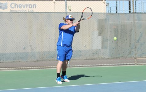 Senior Bryson Ginn returning opponents serve. Bryson had a great season this year in both singles and doubles.