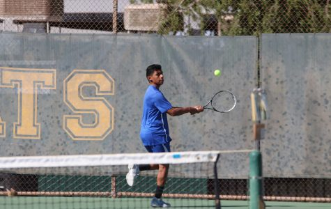 Senior Rodolfo Magana backhands the ball after a serve. He played well and has had a great season.