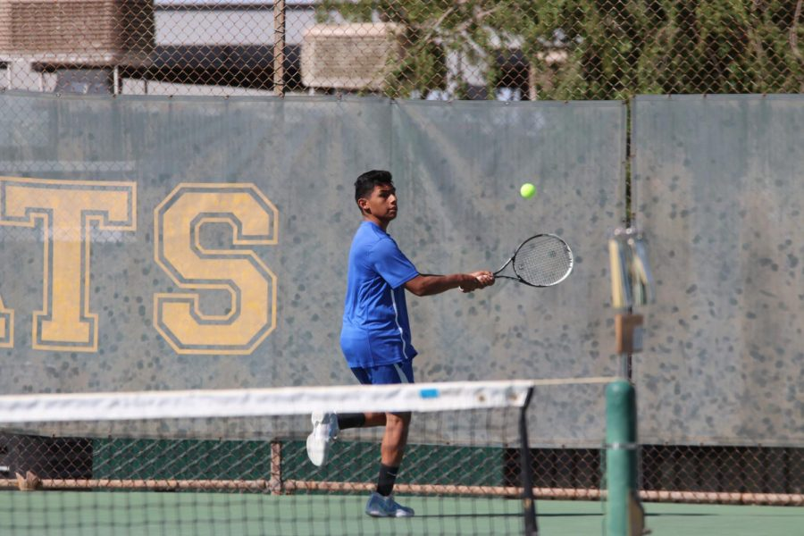 Senior+Rodolfo+Magana+backhands+the+ball+after+a+serve.+He+played+well+and+has+had+a+great+season.