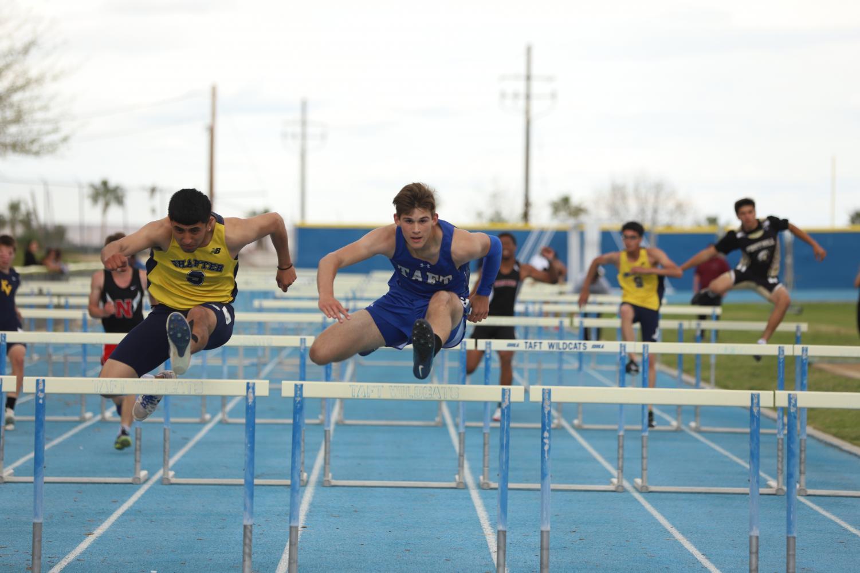 Jonathan Hopkins jumps his last hurdle in his victory in the 110-meter hurdles.