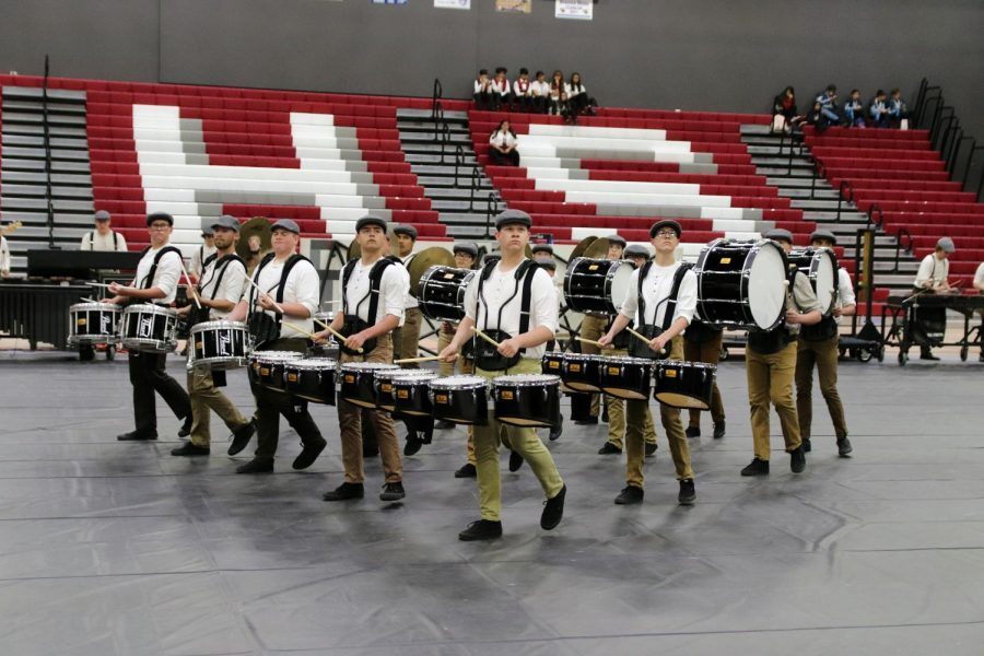 Standing+in+formation%2C+Tanner+Ashmore+leads+the+Drumline+at+the+beginning+of+the+show.+Drum+Captain%2C+Tanner+Ashmore+said%2C%22This+year+has+been+awesome%2C+we+finished+1st+in+PPAACC+finals+in+our+division.+Everyone+works+so+hard+to+achieve+such+a+high+goal.+It%27s+amazing+to+see+everyone+work+together+to+make+a+show+as+good+as+this+one.%22+This+year%27s+Drumline+has+gone+above+and+beyond+to+perfect+telling+the+story+of+Tesla%27s+Tower.+