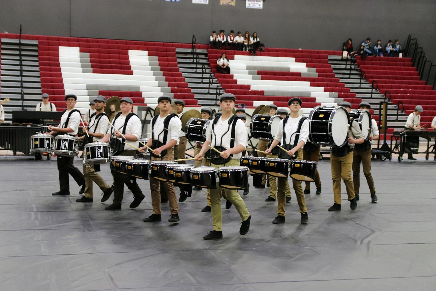 Standing in formation, Tanner Ashmore leads the Drumline at the beginning of the show. Drum Captain, Tanner Ashmore said,