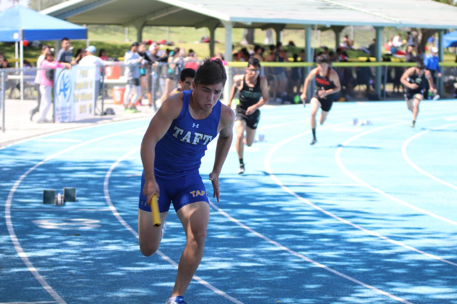 Jordan Miranda runs the first leg in the varsity boys 4x100 meter relay at a previous track meet on April 10.