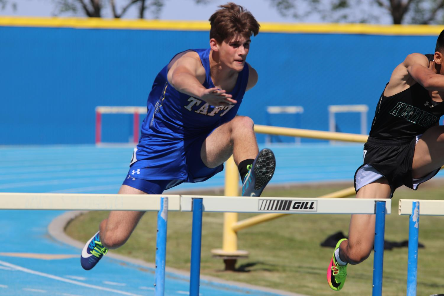 Jonathan Hopkins running through the first hurdle in his win in this league meet.