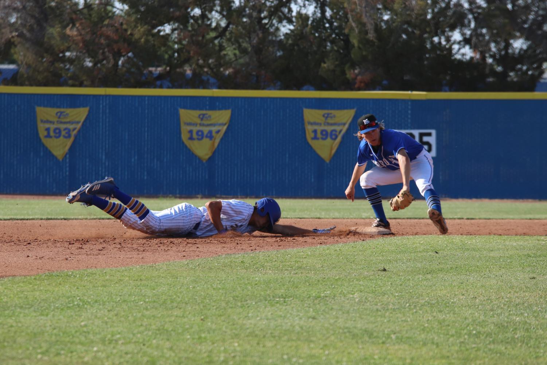 Jacob Ellis sliding back to second base.