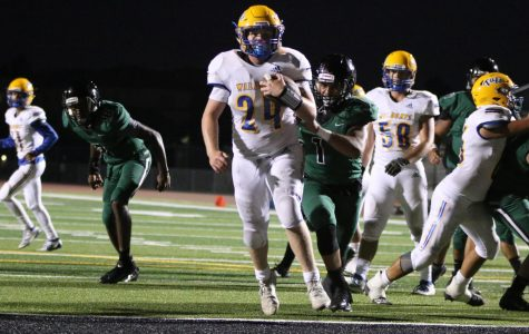 Sophomore Running back Bryce Veach (#24) scores the touchdown for TUHS.