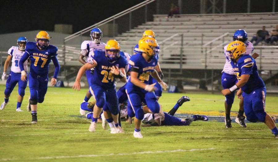 Sophomore Running back Bryce Veach(#24) takes the hand off to the right side the 50-yard line.