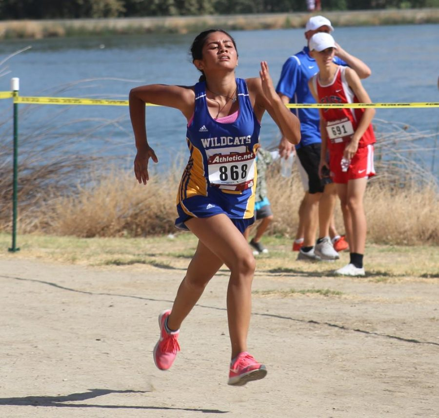 Junior Kimberly Rivera nearing the end of her race at the Lake Ming invitational.