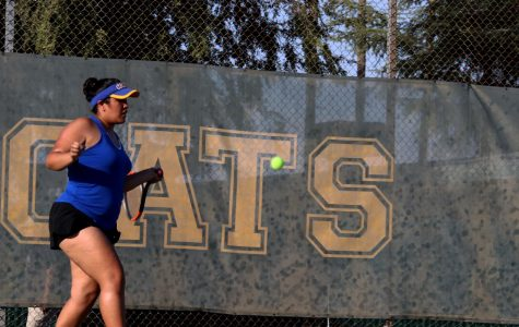 Gabriela Aguliar returning a forehand during her doubles match.