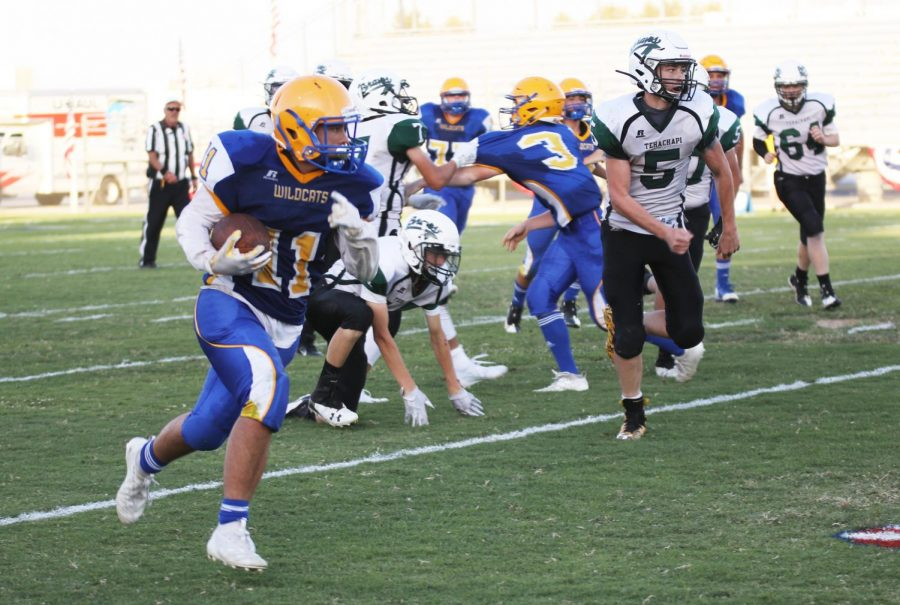 Julian Woodards #11 running the ball to the outside.