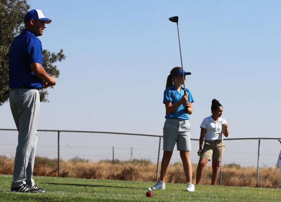 Freshman%2C+Trenadee+Price+getting+ready+to+use+her+driver+with+head+coach%2C+Mike+Cowan+observing.