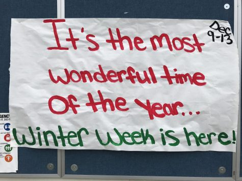 ASB Winter Week poster hanging in the quad to remind students to dress up.