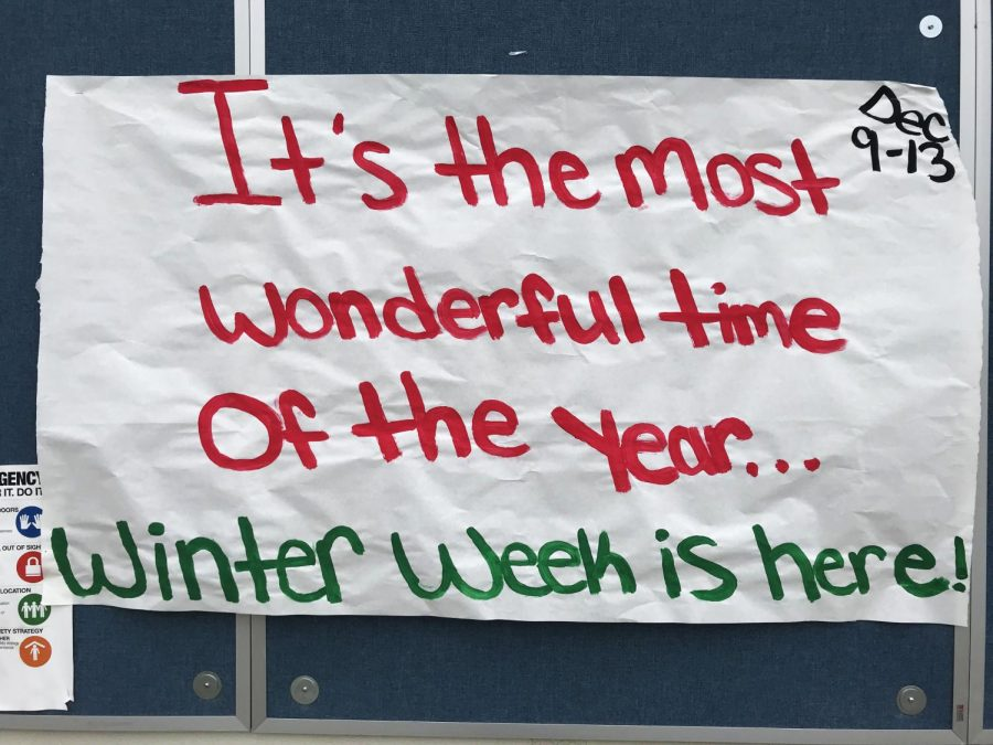 ASB+Winter+Week+poster+hanging+in+the+quad+to+remind+students+to+dress+up.