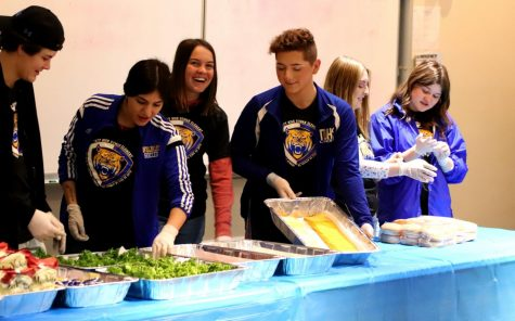 Students from the foods club was handing out food for the students who achieved a 4.oo or higher.