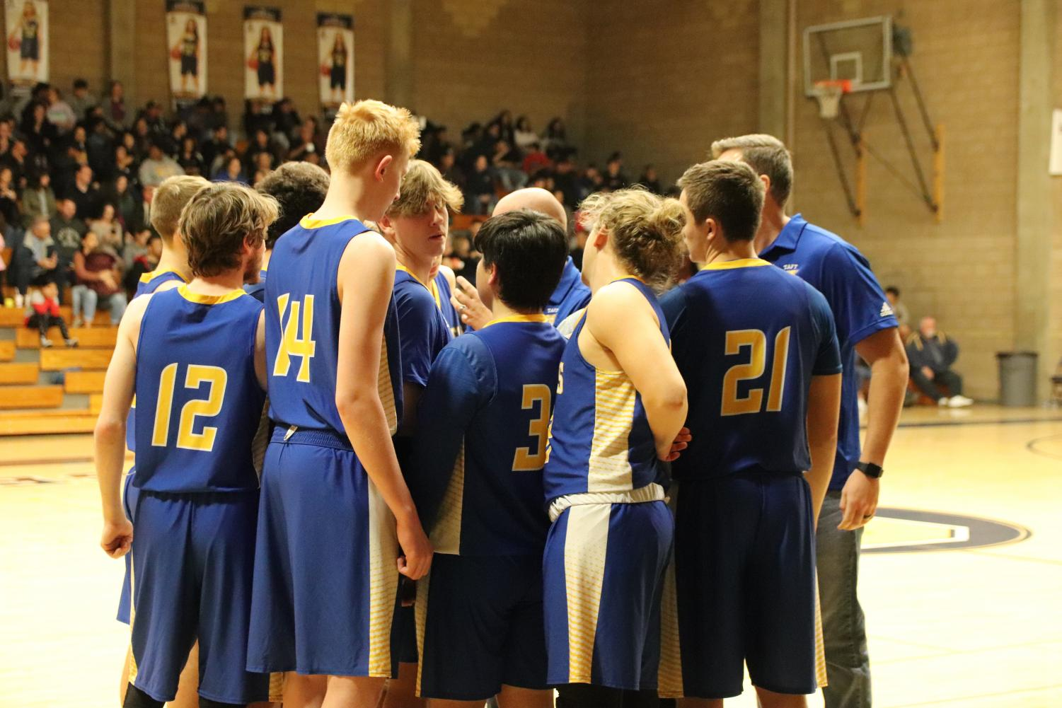 Taft High boys varsity basketball pre-game huddle on Jan. 10 before facing Shafter at Shafter High.
