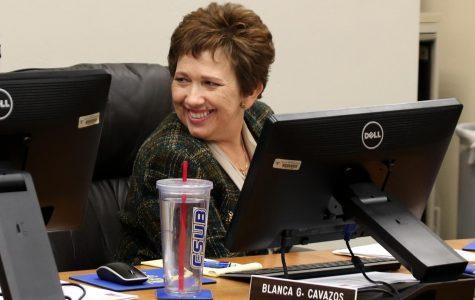 Cavazos smiling at a board meeting last year.