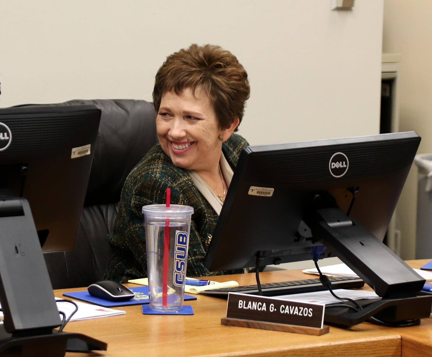 Cavazos smiling at a board meeting last year.