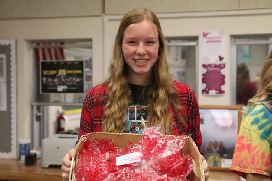 Ashlyn Smith with a box of goodie bags for students and staff from Human Element students.