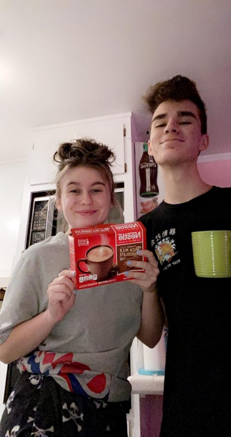 Tina Swope and Erik Blanco celebrating one of their favorite fall traditions: making hot cocoa.