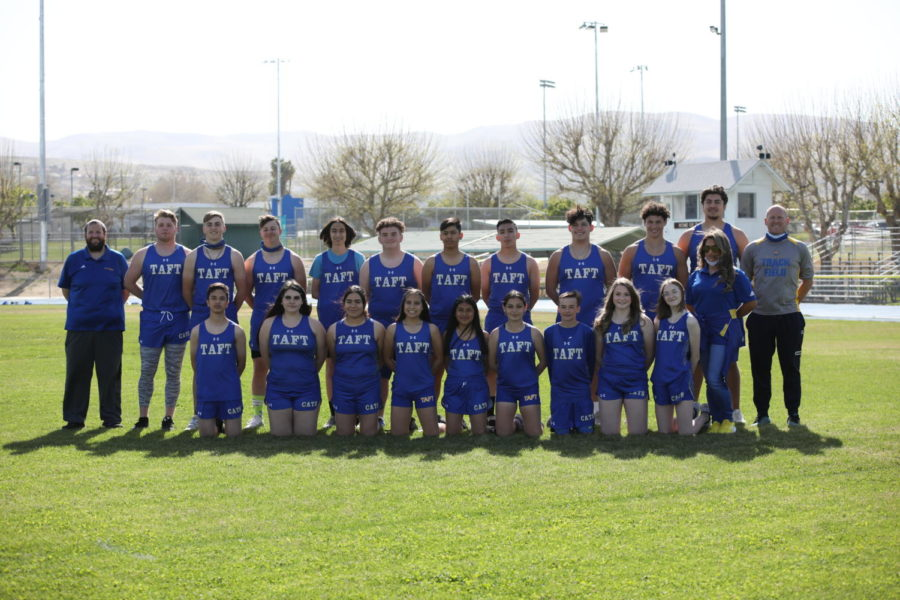 Track and field team posing for a photo.